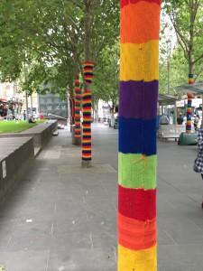 rainbow guerilla knitting poles